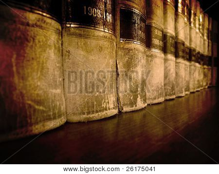Row of old leather law books on a shelf poster