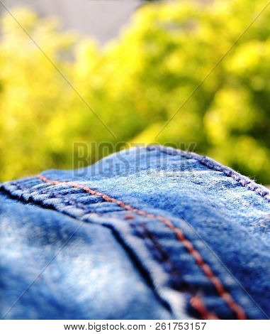 Vibrant Close Up Image Of A Blue Denim Jeans Taken In Bright Sunny Daylight With Blue Brown Double S