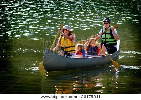 Family in a canoe on a lake in the summer