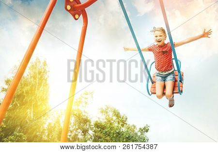Little Girl Swing On Swing And Enjoy The Time