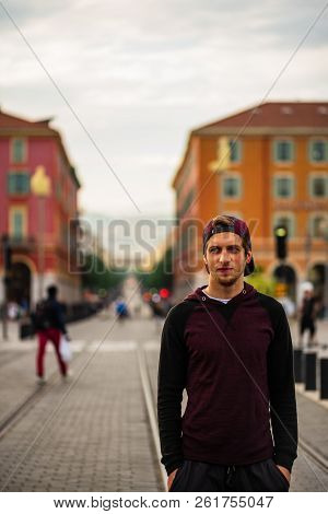 Nice, France - 2018. Young Man On The Tram Tracks Of Nice, France. Downtown Nice, French Riviera.