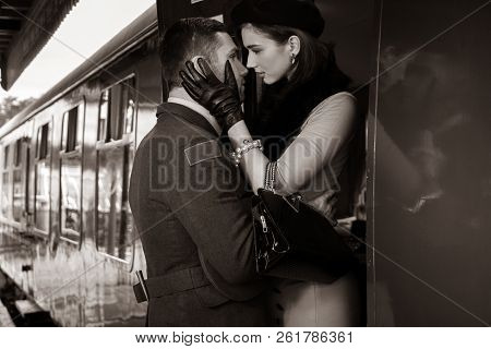Vintage Couple Embracing On Railway Station Platform As Train Is About To Depart