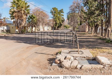 Loxton, South Africa, August 7, 2018: A Street Scene, With An Historic Hand-operated Water Pump, In