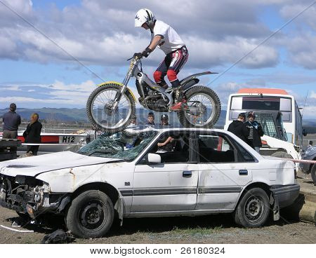 Trick Rider on Top of a Car