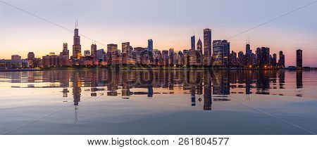 Panorama Of Cityscape Skyline Of Chicago From The Old Observatory At Sunset And Reflected In Artific