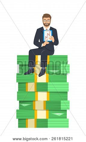 Businessman In Business Suit Sitting On A Top Of Stack Of Paper Money And Showing A Graph Of Income