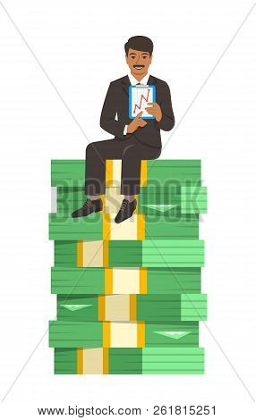 Indian Businessman In Business Suit Sitting On A Top Of Stack Of Paper Money And Showing A Graph Of