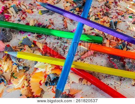 A Bunch Of Colored Pencils On A Pile Of Colored Pencil Shavings, Sharpened Pencils