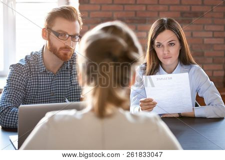 Serious Thoughtful Hr Attentively Listening To Applicant At Job