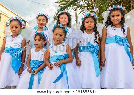 Cuidad Vieja,, Guatemala -  December 7, 2017: Girls Dressed Up As Angels In Parade Celebrating Our L