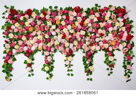 Wedding Decoration - Composition Of Colorful Roses And Peonies Flowers Over White Wall