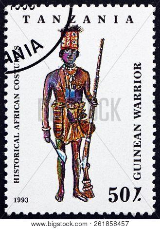 Tanzania - Circa 1993: A Stamp Printed In Tanzania Shows Guinean Warrior, Historical African Costume