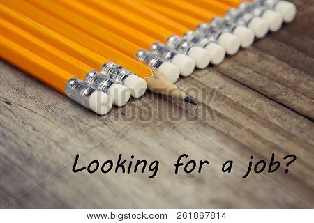 Looking For A Job Inscription. Hiring Hire Recruitment. Cup Of Coffee And Yellow Pencil Over Rustic