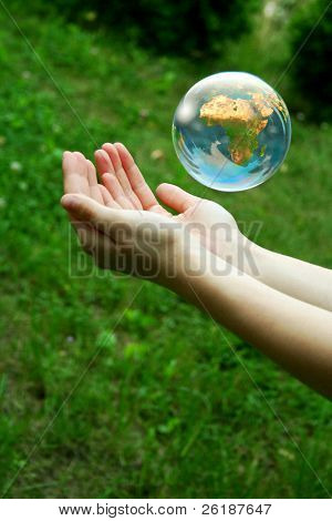 A globe above the women hand