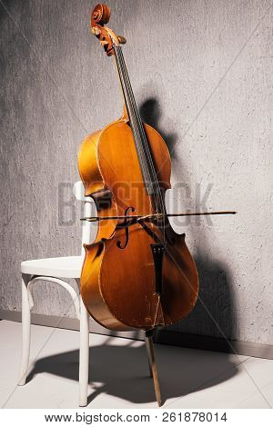 Violin On Chair At School Or Practice Room ,during The Practice Break Time To Prepare For The Concer
