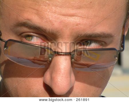Young Attractive Man Looking Over His Sunglasses