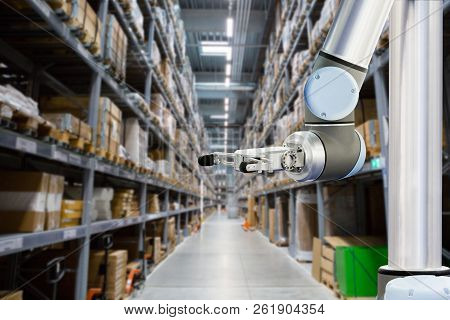 Roboric Arm Is Working In A Modern Warehouse