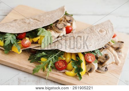 Whole Wheat Wraps With Mushrooms, Chicken Breast, Yellow Capsicum, Parsley, Arugula And Red Cherry T