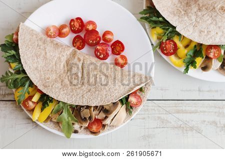 Serving Of Healthy Sandwich With Chicken Meat And Vegetables. Whole Wheat Wrap With Chicken Breast,