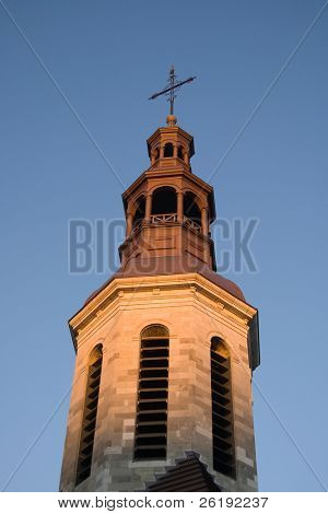 church spire glowing in dusk light at sunset; Quebec City, Canada