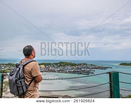 Asisn Fat Backpacker stand on top of  Khao Ma Jor Pier  with Idyllic ocean beautiful white cloud endless horizon and Fishman townscape in vacation time,chonburi thailand,holiday concept poster