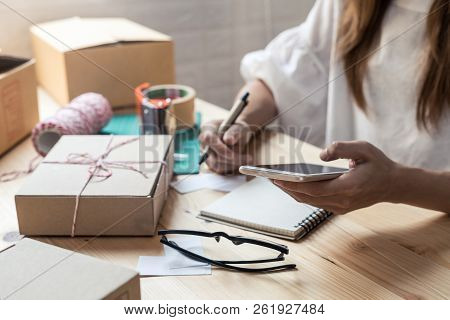 Young Startup Small Business Entrepreneur Woman Working With Smart Phone At Home, Online Business An