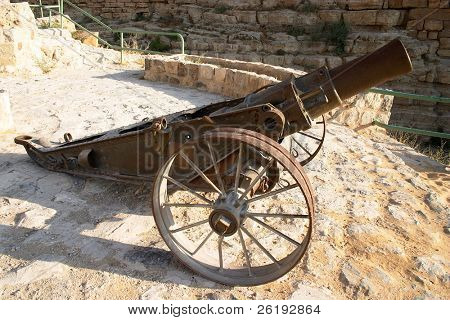 A small cannon, from the Ottoman era and the time of the Arab Revolt let by Lawrence of Arabia. It is outside Karak Castle, Jordan. poster