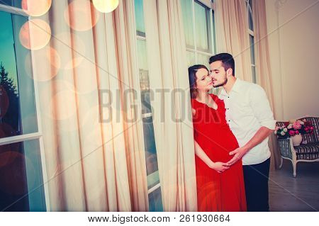 Happy Couple Kiss In The Living Room Having, The Light Give A Cozy Atmosphere. Saint Valentine's Day