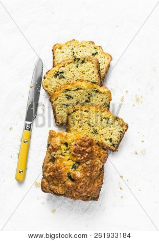 Savory Spinach, Feta And Squash Loaf On A Light Background, Top View