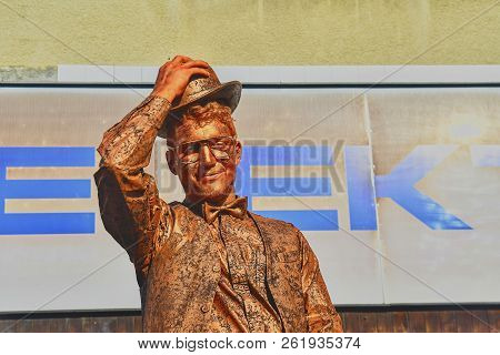 Hustopece, Czech Republic - October 7, 2018: Cupreous Painted Artist Like Living Statue Dressed Like