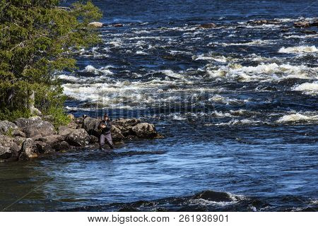 Kalix River, Sweden On June 26. View Of Rapids In The Kalix River, An Unidentified Fisherman On June
