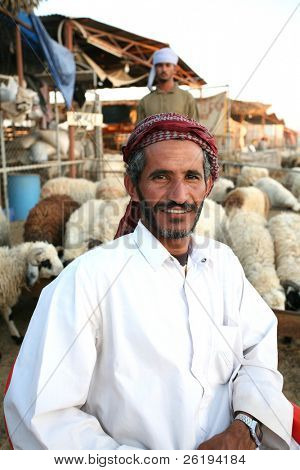 Arab shepherds at the livestock market in Doha, Qatar, with their flock. No release, editorial use only.