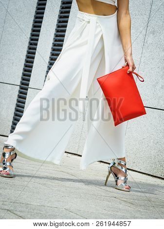 Unrecognizable Fashionable Woman Wearing High Fashion Fashionable Outfit Showing Red Purse Bag