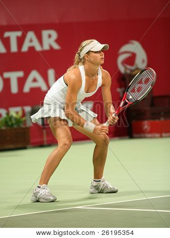 Maria Kirilenko of Russia in action against Martina Hingis in the Qatar Total Open, February 28, 2007.