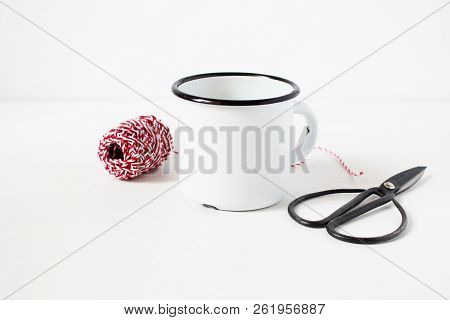 Winter Still Life Composition With Blank White Metal Coffee Mug, Vitage Scissors And Red Decorative