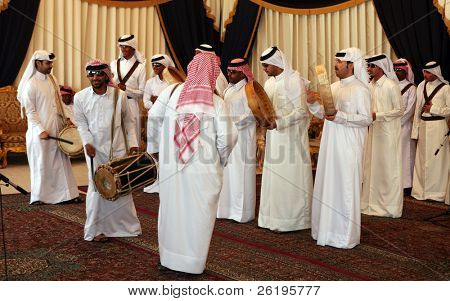 A Qatari folklore troupe performing on traditional instruments and singing during the Doha Cultural Festival 2007.