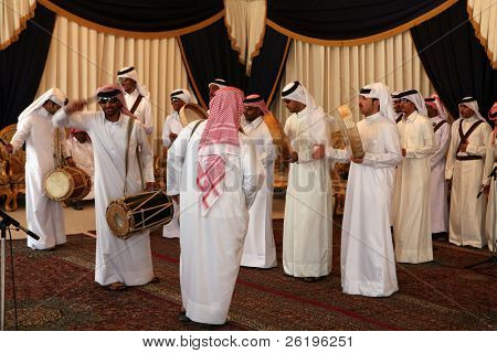 Qatar's national folklore troupe perfoming a traditional dance at a cultural event in Doha, April 4, 2007
