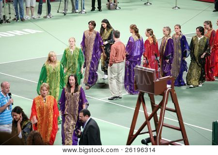 Top seed Ana Ivanovic (bottom left) leads off top-10 ranked players Kuznetsova, Jankovic, Sharapova, Chakvetadze, V Williams and Bartoli at the end of the opening ceremony for the Qatar 2008 Open