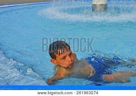Cute Little Boy In The Public Swimming Pool. Portrait Of Little Cute Boy In The Swimming Pool. Sunny