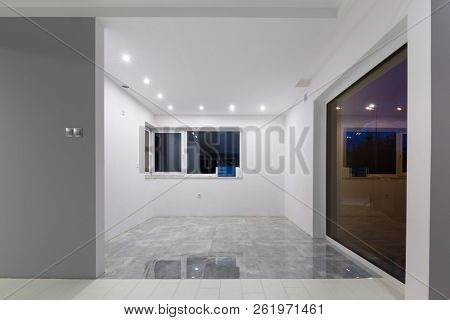 Living room with new laminated floor and decorative wall
