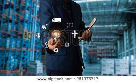 Business Logistics Concept, Businessman Manager Touching Icon For Logistics On Modern Trade Warehous