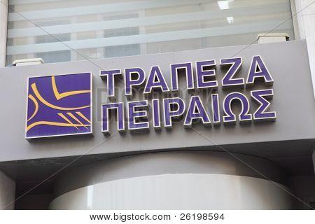 HERAKLION, GREECE - JULY 27: A Piraeus Bank, Heraklion (Iraklio), Crete branch sign. In June 2011 Piraeus Bank's Greek part of Greek State debt was 8,700 million euros. July 27, 2010 in Heraklion, Crete, Greece