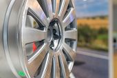 Metal disc wheel for the car at an exhibition.Selective focus.Modern store with alloy wheels and tires, indoors.Aluminum metal wheel rim texture. Car alloy wheel, isolated poster