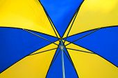 An abstract shot of an umbrella with vivid colors. poster