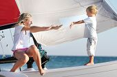 loving mother and son on board of sea yacht poster