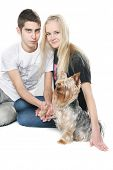 young happy couple with yorkshire terrier over white poster