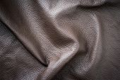 Brown genuine vintage wavy leather as background wallpaper with copy space poster