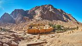 Panorama of the Sacred Monastery of God-Trodden Mount Sinai (St Catherine Monastery), surrounded by huge fortress wall, Sinai, Egypt. poster