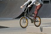 teenager boy doing stunts jumps on a bmx bike in the Park poster