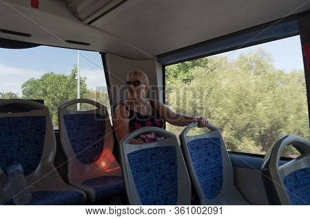 Transport, Tourism, Road Trip And People Concept - Group Of Happy Passengers Or Tourists In Travel B
